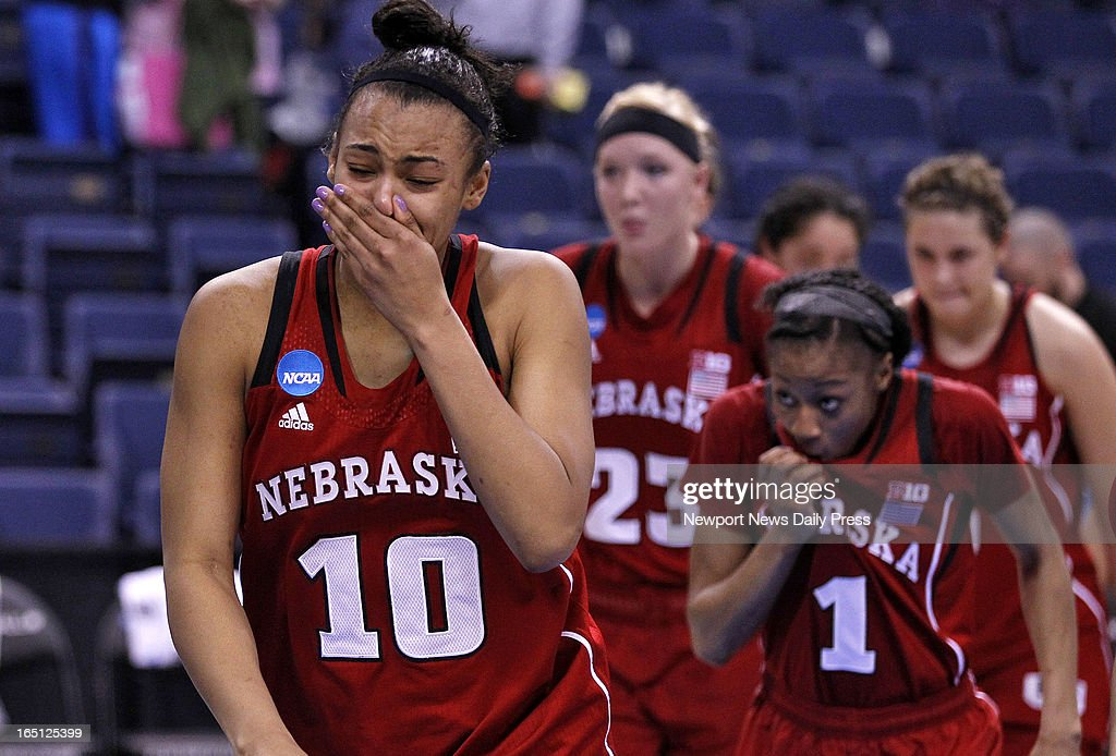 Nebraska's Meghin Williams, left, walks off the court in disappointment after the Cornhuskers loss to Duke during Sunday's NCAA women's basketball regional semifinal on March 31, 2013, at the Ted Constant Center in Norfolk, Virginia. Duke won, 53-45.
