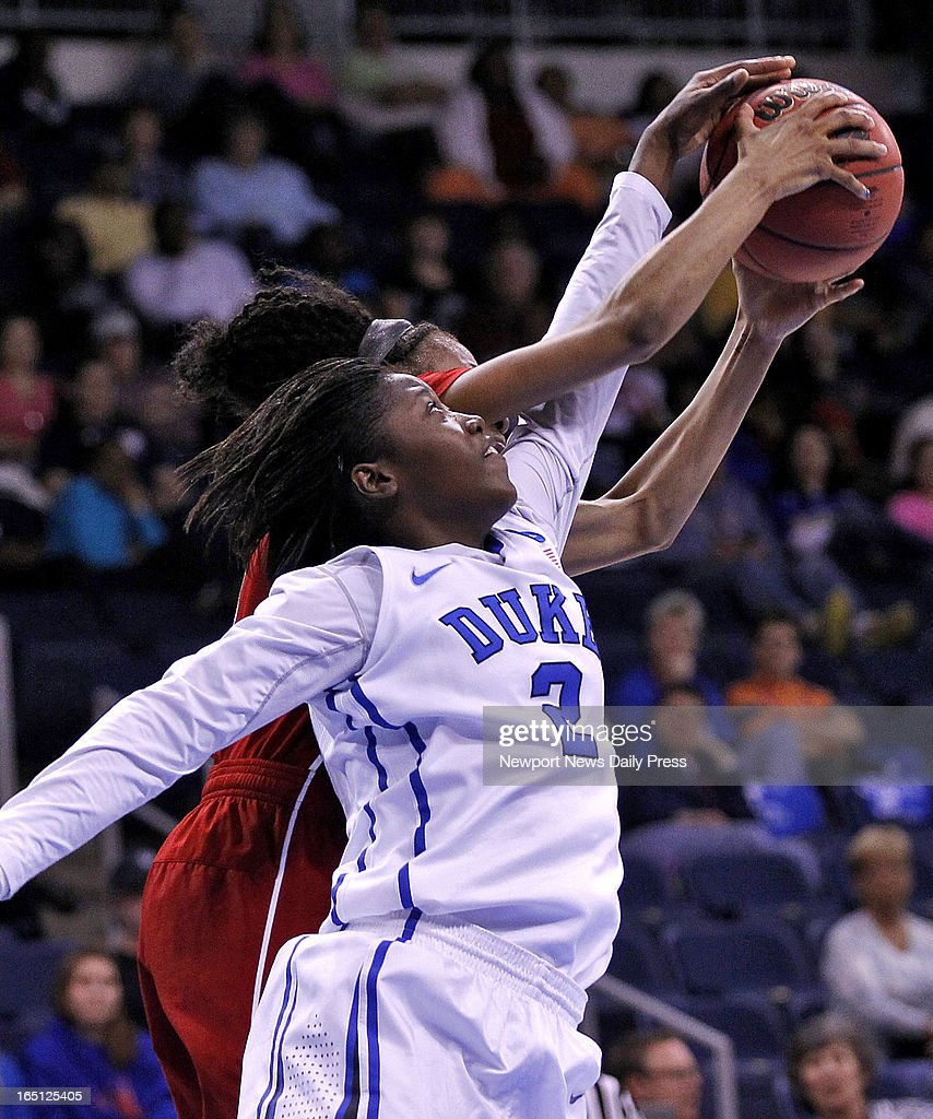 Nebraska's Tear'a Laudermill, left, and Duke's' Alexis Jones battle for a rebound during Sunday's NCAA women's basketball regional semifinal on March 31, 2013, at the Ted Constant Center in Norfolk, Virginia. Duke won, 53-45.