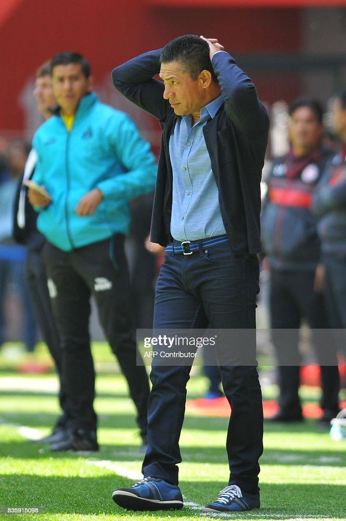 Necaxa's coach Ignacio Ambriz gestures during the Mexican Apertura football tournament match against Toluca at the Nemesio Diez stadium in Toluca, Mexico, on August 20, 2017. /