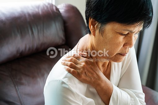 neck and shoulder pain, old woman suffering from neck and shoulder injury, health problem concept : Stock Photo