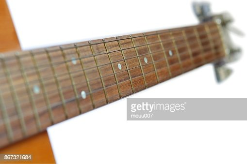 Neck Of Acoustic Guitar Isolated On White Background Selective Focus