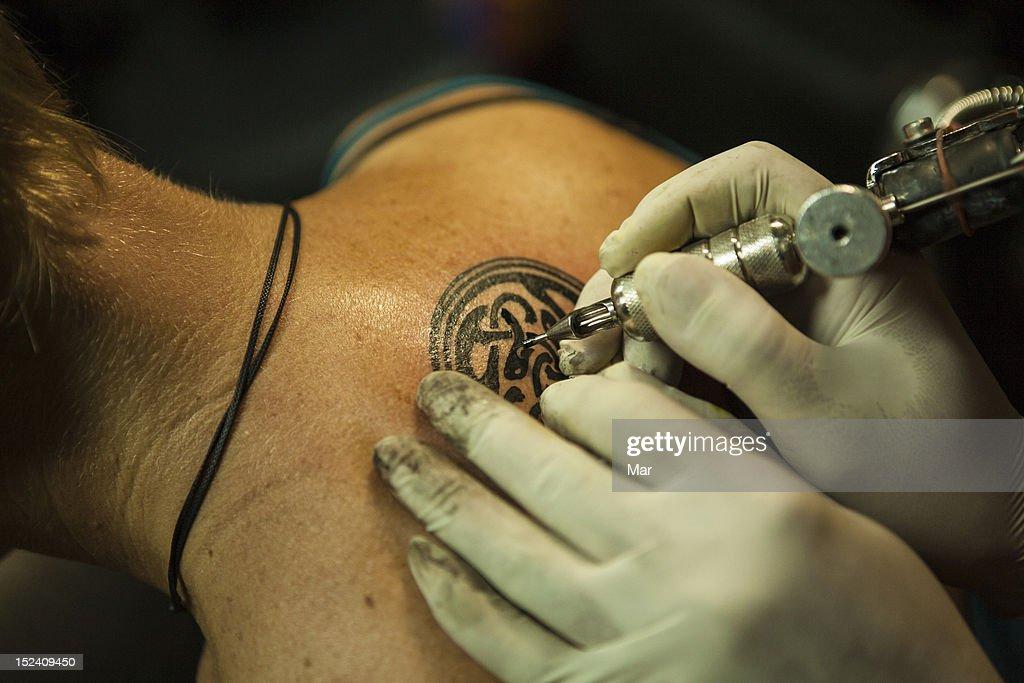 Neck tattoo : Stock Photo