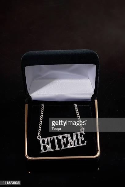 Necklace in Velvet case saying 'Bite Me'