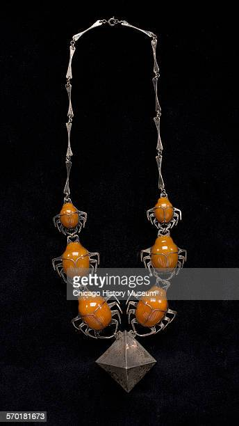 Necklace of sterling silver and carved amber titled Homage to Egypt designed by Robert R Macklow Chicago Illinois 1970