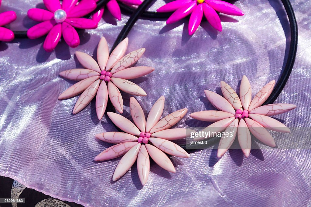 necklaces shaped pink flowers : Stock Photo