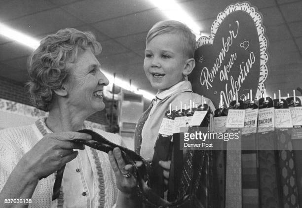 A necktie for dad as a possible Valentine's Day gift is being considered by Mrs Harry Cook 405 Perry st and her son Jay during their visit Howell's...