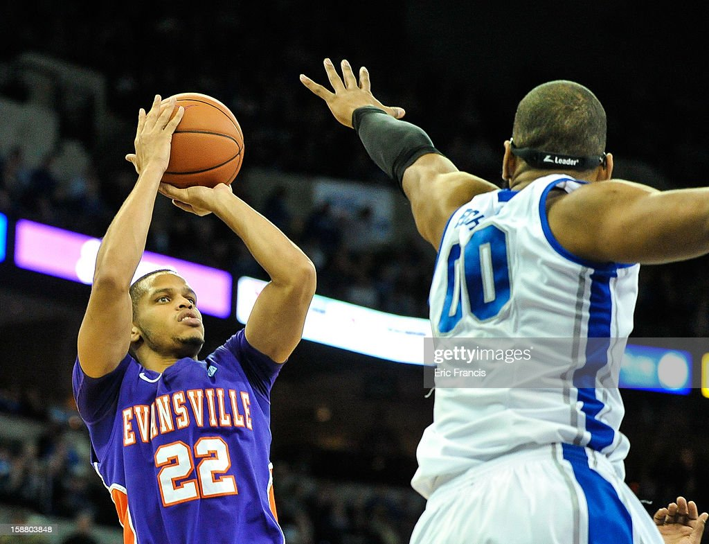 Ned Cox #22 of the Evansville Aces takes a shot over Gregory Echenique #0 of the Creighton Bluejays during their game at the CenturyLink Center on December 29, 2012 in Omaha, Nebraska.
