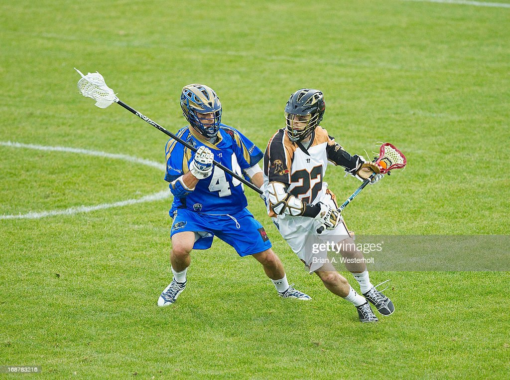 Ned Crotty #22 of the Rochester Rattlers is marked by Brett Schmidt #44 of the Charlotte Hounds during first half action at American Legion Memorial Stadium on May 11, 2013 in Charlotte, North Carolina. The Rattlers defeated the Hounds 13-10.