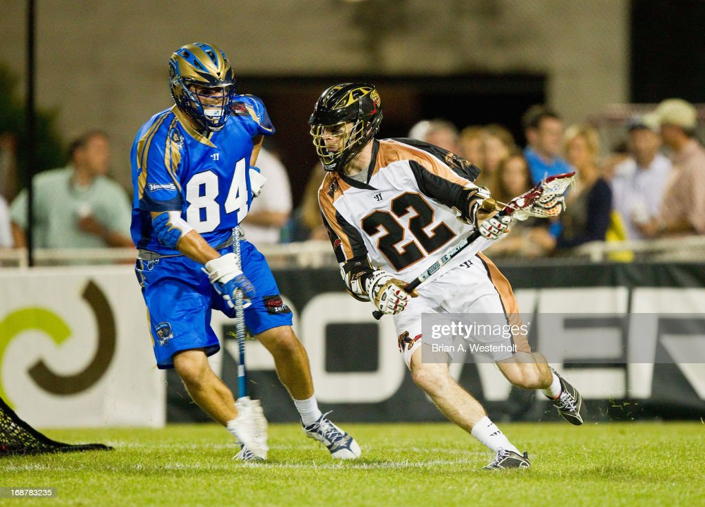 Ned Crotty #22 of the Rochester Rattlers makes a move to get past Joe Cinosky #84 of the Charlotte Hounds during second half action at American Legion Memorial Stadium on May 11, 2013 in Charlotte, North Carolina. The Rattlers defeated the Hounds 13-10.