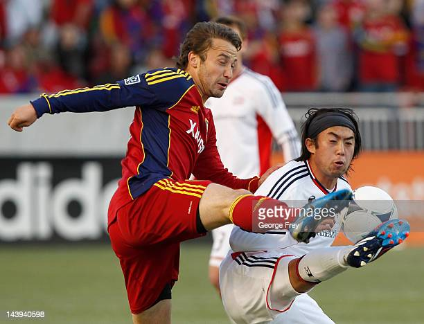 Ned Grabavoy of Real Salt Lake and Lee Nguyen of the New Engeland Revolution fight for the ball during the first half of an MLS soccer game May 5...