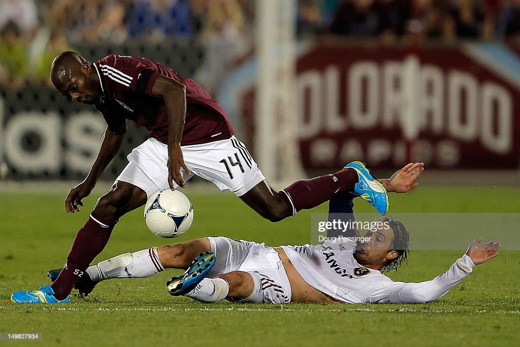 Ned Grabavoy of Real Salt Lake contests Omar Cummings of Colorado Rapids for control of the ball at Dick's Sporting Goods Park on August 4 2012 in...