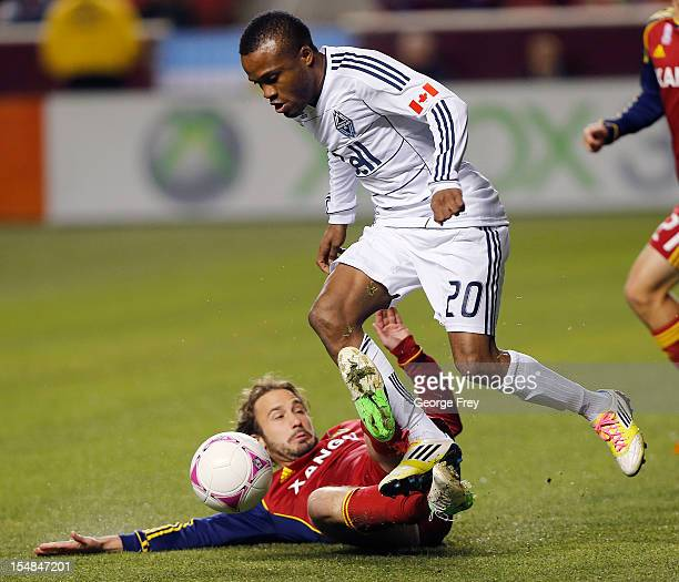 Ned Grabavoy of Real Salt Lake tries to take the ball from Dane Richards of Vancouver Whitecaps during the first half of an MLS soccer game October...