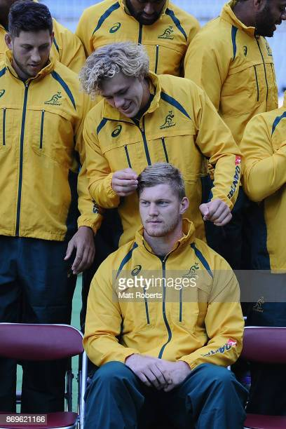 Ned Hanigan adjusts the hair of Matt Philip during the team photo prior to the Australia Captain's Run at Nissan Stadium on November 3 2017 in...