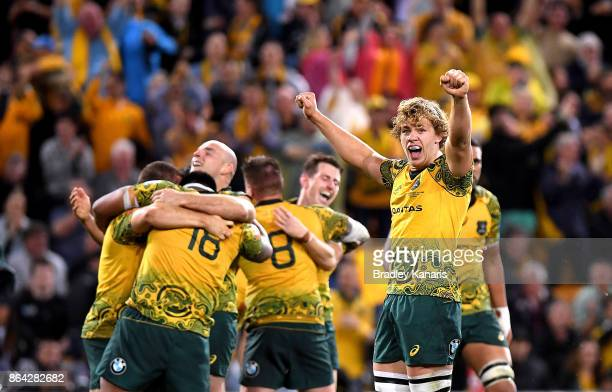 Ned Hanigan and Stephen Moore of the Wallabies and team mates celebrate victory after the Bledisloe Cup match between the Australian Wallabies and...