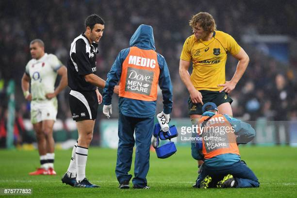 Ned Hanigan of Australia recieves treatment during the Old Mutual Wealth Series match between England and Australia at Twickenham Stadium on November...