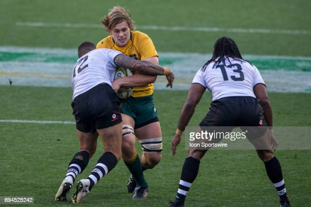 Ned Hanigan of the Australian Wallabies Rugby Union Team is tackled by Jale Vatubua of the Fijian Rugby Union Team during the International Friendly...