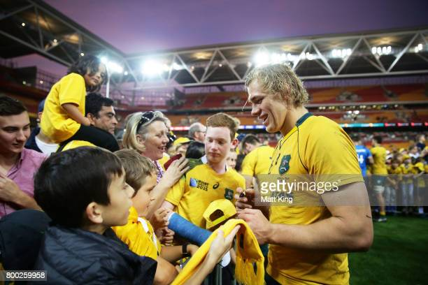 Ned Hanigan of the Wallabies interacts with fans after the International Test match between the Australian Wallabies and Italy at Suncorp Stadium on...
