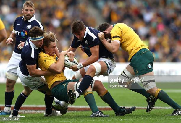 Ned Hanigan of the Wallabies is tackled by Ryan Wilson of Scotland during the International Test match between the Australian Wallabies and Scotland...