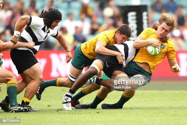 Ned Hanigan of the Wallabies is tackled during the match between the Australian Wallabies and the Barbarians at Allianz Stadium on October 28 2017 in...