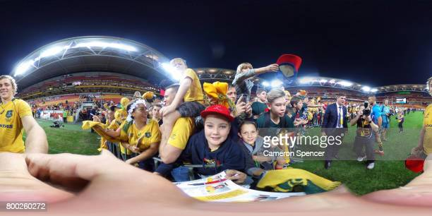 Ned Hanigan of the Wallabies poses with Wallabies fans during the International Test match between the Australian Wallabies and Italy at Suncorp...