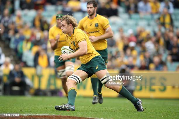 Ned Hanigan of the Wallabies runs the ball during the International Test match between the Australian Wallabies and Scotland at Allianz Stadium on...