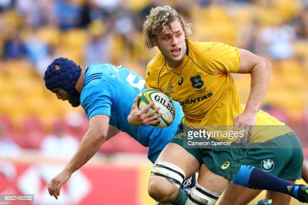 Ned Hanigan of the Wallabies runs the ball during the International Test match between the Australian Wallabies and Italy at Suncorp Stadium on June...