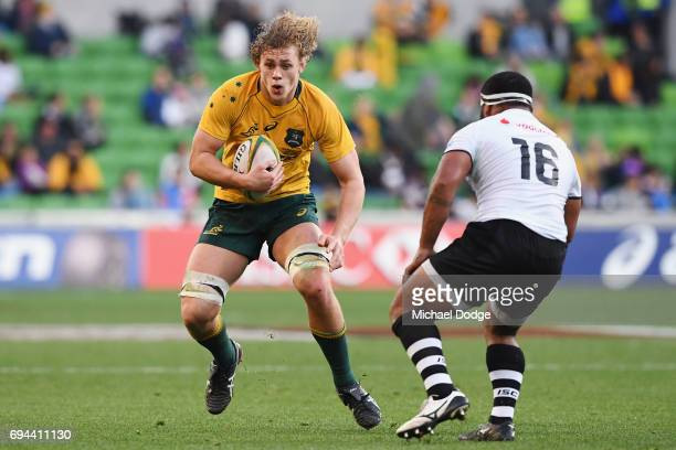 Ned Hanigan of the Wallabies runs with the ball during the International Test match between the Australian Wallabies and Fiji at AAMI Park on June 10...