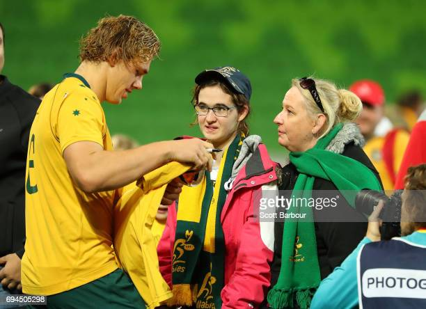Ned Hanigan of the Wallabies signs autographs for supporters in the crowd after the International Test match between the Australian Wallabies and...