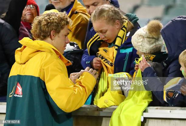 Ned Hanigan of the Wallabies signs autographs for supporters in the crowd after The Rugby Championship match between the Australian Wallabies and the...