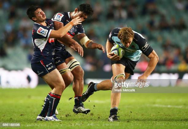 Ned Hanigan of the Waratahs breaks tackles during the round 13 Super Rugby match between the Waratahs and the Rebels at Allianz Stadium on May 21...