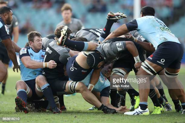 Ned Hanigan of the Waratahs is flipped over in the maul during the round six Super Rugby match between the Waratahs and the Crusaders at Allianz...