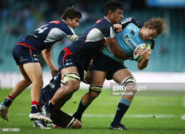 Ned Hanigan of the Waratahs is tackled during the round 13 Super Rugby match between the Waratahs and the Rebels at Allianz Stadium on May 21 2017 in...