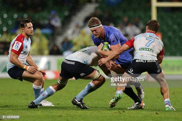 Ned Hanigan of the Waratahs is tackled during the round 17 Super Rugby match between the Force and the Waratahs at nib Stadium on July 15 2017 in...
