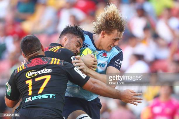 Ned Hanigan of the Waratahs is tackled during the Rugby Global Tens match between Waritahs and Chiefs at Suncorp Stadium on February 11 2017 in...
