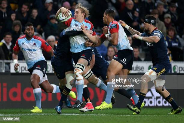 Ned Hanigan of the Waratahs runs the ball during the round 14 Super Rugby match between the Highlanders and the Waratahs at Forsyth Barr Stadium on...