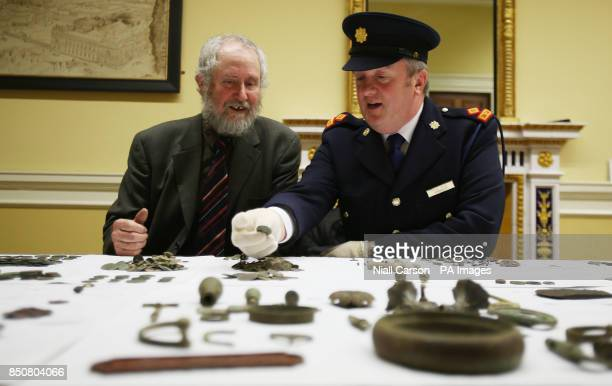 Ned Kelly keeper of antiquities at the National Museum of Ireland and Garda Superintendent David Taylor view some of the 900 artefacts illegally...