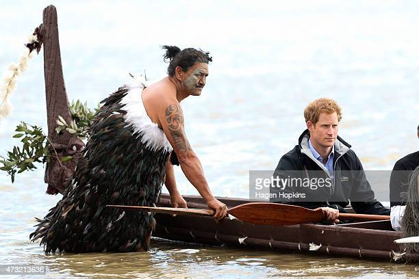 Ned Tapa and Prince Harry prepare to paddle a waka down the Whanganui River after a visit to Putiki Marae on May 14 2015 in Wanganui New Zealand...