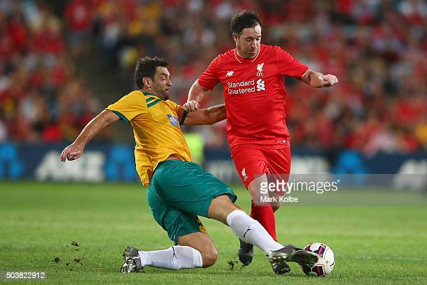Ned Zelic of the Australian Legends tackles Robbie Fowler of the Liverpool FC Legends uring the match between Liverpool FC Legends and the Australian...