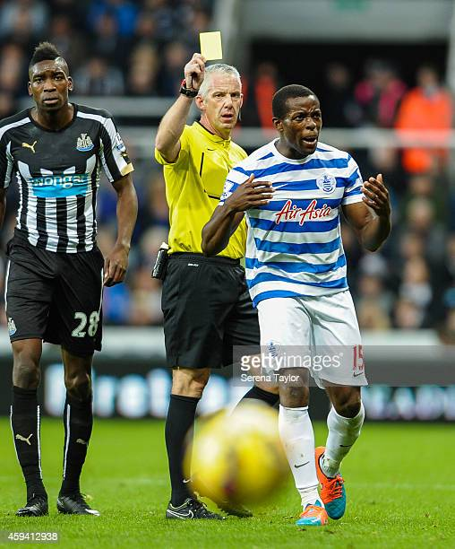 Nedum Onuhoa of Queens Park Rangers receives a yellow card from Referee Chris Foy after fouling Sammy Ameobi of Newcastle during the Barclays Premier...