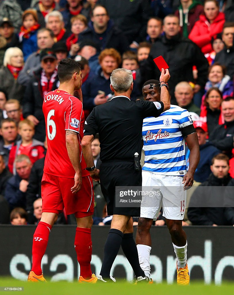 <a gi-track='captionPersonalityLinkClicked' href=/galleries/search?phrase=Nedum+Onuoha&family=editorial&specificpeople=2082844 ng-click='$event.stopPropagation()'>Nedum Onuoha</a> of QPR is shown the red card by referee <a gi-track='captionPersonalityLinkClicked' href=/galleries/search?phrase=Martin+Atkinson&family=editorial&specificpeople=703318 ng-click='$event.stopPropagation()'>Martin Atkinson</a> during the Barclays Premier League match between Liverpool and Queens Park Rangers at Anfield on May 2, 2015 in Liverpool, England.