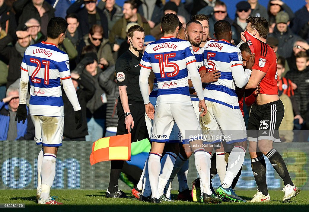 Nedum Onuoha of Queens Park Rangers (C) and Chris Martin of Fulham FC (R) confront each other during the Sky Bet Championship match between Queens Park Rangers and Fulham at Loftus Road on January 21, 2017 in London, England.