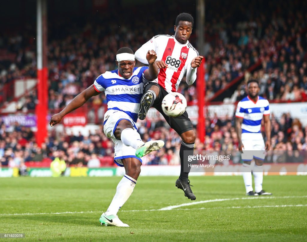 Nedum Onuoha of Queens Park Rangers and Florian Jozefzoon of Brentford challenge for the ball during the Sky Bet Championship match between Brentford and Queens Park Rangers at Griffin Park on April 22, 2017 in Brentford, England.