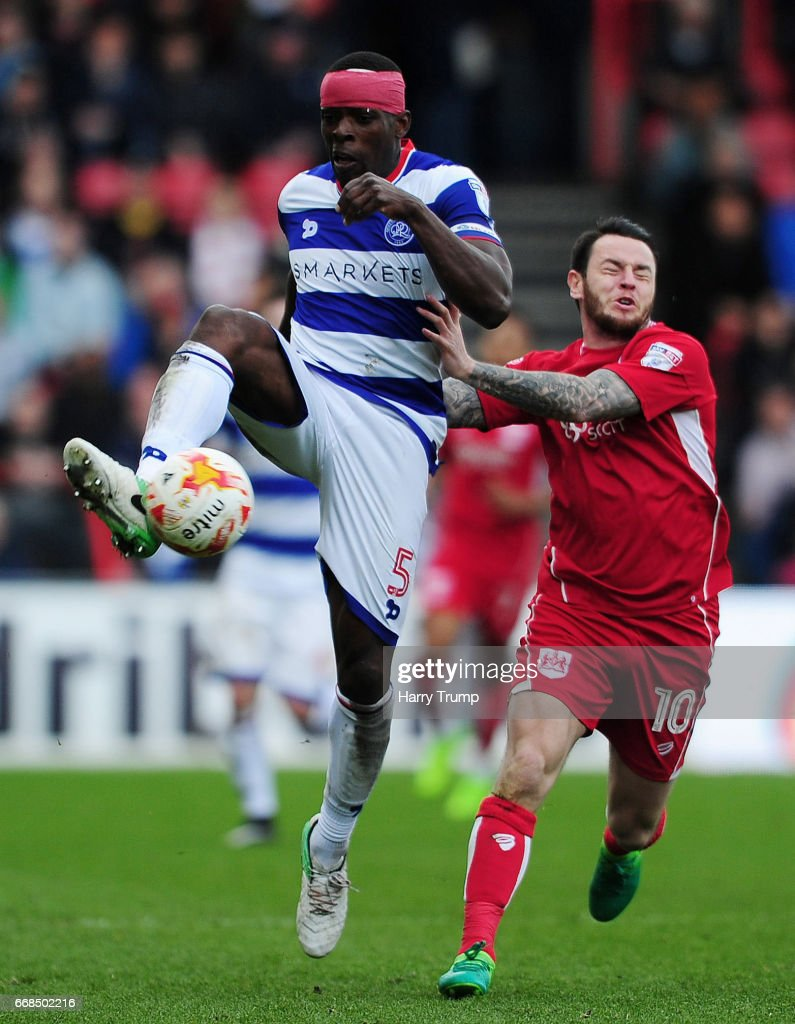 Nedum Onuoha of Queens Park Rangers is tackled by Lee Tomlin of Bristol City during the Sky Bet Championship match between Bristol City and Queens Park Rangers at Ashton Gate on April 14, 2017 in Bristol, England.