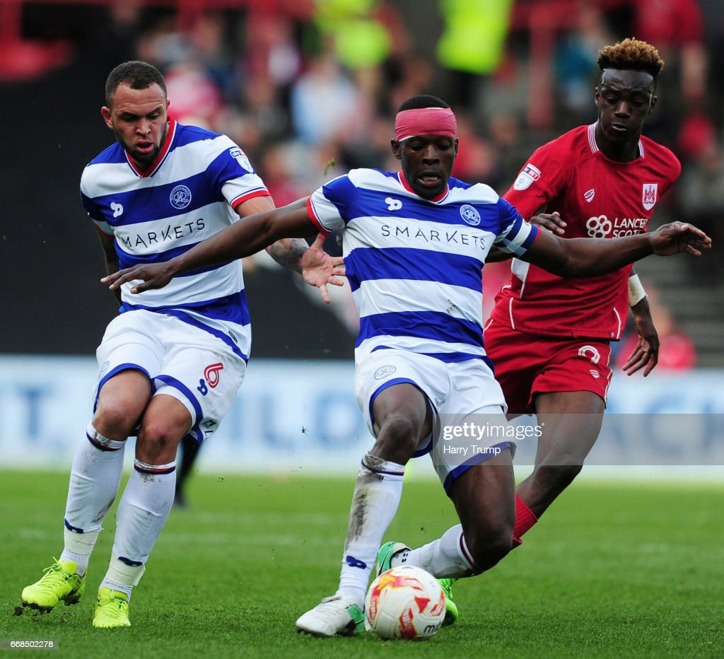 Nedum Onuoha of Queens Park Rangers is tackled by Tammy Abraham of Bristol City during the Sky Bet Championship match between Bristol City and Queens Park Rangers at Ashton Gate on April 14, 2017 in Bristol, England.