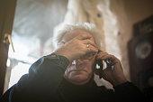 Senior man having headache,calling for help.