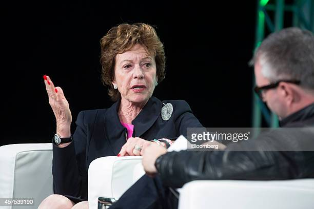 Neelie Kroes member of the European Commission in charge of the development of online markets left speaks during a panel session at the Disrupt...