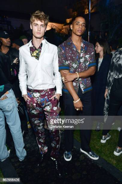 Neels Visser and Cordell Broadus at HM x ERDEM Runway Show Party at The Ebell Club of Los Angeles on October 18 2017 in Los Angeles California