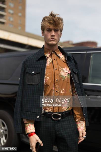 Neels Visser is seen attending Coach during New York Fashion Week wearing a green suit with brown shirt on September 12 2017 in New York City