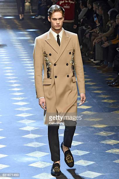 Neels Visser walks the runway at the Dolce Gabbana Autumn Winter 2017 fashion show during Milan Menswear Fashion Week on January 14 2017 in Milan...