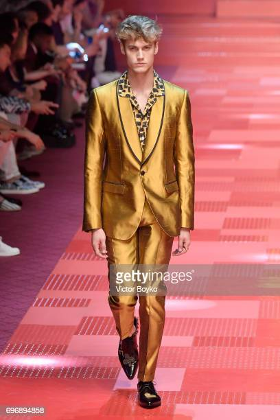 Neels Visser walks the runway at the Dolce Gabbana show during Milan Men's Fashion Week Spring/Summer 2018 on June 17 2017 in Milan Italy